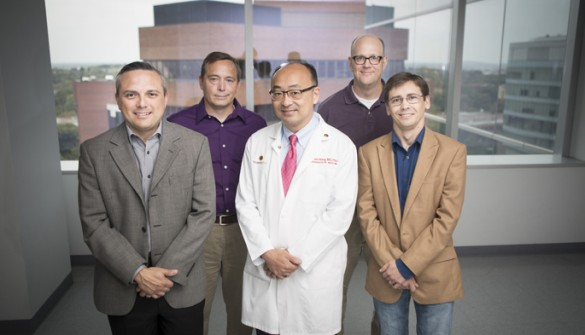 The Vanderbilt team working to develop new compounds that could have therapeutic potential for a broad range of diseases includes (front row, from left) Michael Villalobos, Ph.D., Charles Hong, M.D., Ph.D., Daniel Perrien, Ph.D., (back row, from left) Craig Lindsley, Ph.D., and Corey Hopkins, Ph.D. (photo by Susan Urmy)